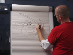 Neill Cameron drawing at a comic book workshop