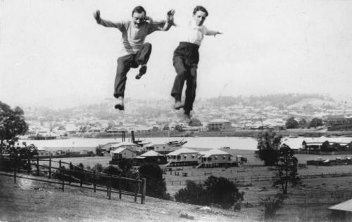 Two men jumping in early 20th century Brisbane