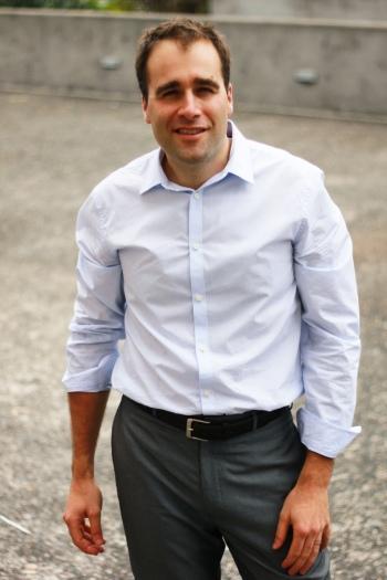 Stefan Hajkowicz standing outdoors, facing the camera