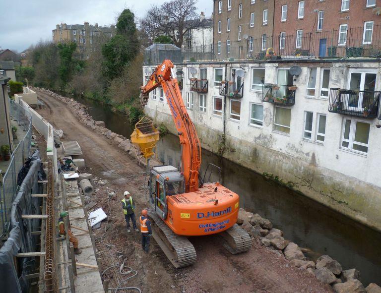 Construction_of_flood_defences,_Bonnington_Bridge_Edinburgh_2012